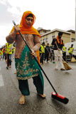 Sikh devotee sweeps the road barefooted at 2013 Baisakhi festival in Brescia Stock Photos