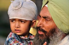 Sikh Father and Son. At the ceremonial of the border between India and Pakistan Royalty Free Stock Photos