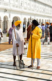 Sikh Guard and Sikh Cleaning Man Royalty Free Stock Images