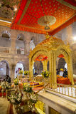 Sikh Gurdwara. Delhi, India - December 26, 2014; Darbar Sahib is the main hall of a Sikh Gurdwara where the holy text, is placed on a takhat or throne in a Royalty Free Stock Image