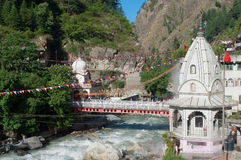 Sikh Gurudwara and a bridge across the river Parvati in the Himalayas. India Royalty Free Stock Images