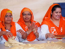 Sikh Ladies Making Bread And Celebrating Vaisakhi Royalty Free Stock Images