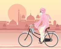 Sikh man on a bicycle. An illustration of a sikh man on a bicycle travelling along a hot city road at sunset in traditional dress with a tiffin and mughal Stock Photos