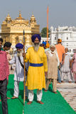 Sikh man and indian people visiting the Golden Temple in Amritsar, Punjab, India. Royalty Free Stock Image