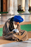 Sikh man praying in Golden Temple in the early morning. Amritsar. India Royalty Free Stock Photography