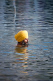 Sikh man praying in the holy lake at Golden Temple . Amritsar. India Royalty Free Stock Images