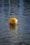 Sikh man praying in the holy lake at Golden Temple . Amritsar. India Royalty Free Stock Image