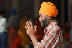 Sikh man praying in Agra Rajastan india. Sikh man praying wearing orange turban in Agra Rajastan Royalty Free Stock Image