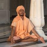 Sikh man visiting the Golden Temple in Amritsar, Punjab, India. AMRITSAR, INDIA - SEPTEMBER 27, 2014: Unidentified Indian man meditates in the Golden Temple in Royalty Free Stock Photo