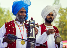 Sikh musicians in the Punjab, India. Two male sikh musicians, dressed in traditional clothes, playing at a festival in the Punjab, India Stock Photos