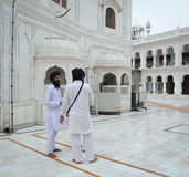 Sikh people standing at the Golden Temple in Amritsar, India Royalty Free Stock Photo