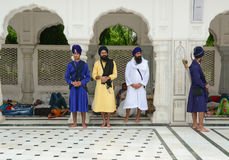 Sikh people standing at Golden temple in Amritsar, India Royalty Free Stock Images