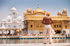 Sikh pilgrim prepearing to immerse in holy tank near Golden Temple Sri Harmandir Sahib, Amritsar Royalty Free Stock Images