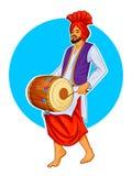 Sikh Punjabi Sardar playing dhol and dancing bhangra on holiday like Lohri or Vaisakhi Royalty Free Stock Images