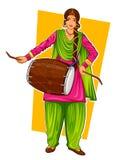 Sikh Punjabi Sardar woman playing dhol and dancing bhangra on holiday like Lohri or Vaisakhi Stock Image