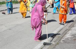 Sikh religion women during the ceremony  while sweeping the stre Royalty Free Stock Images
