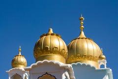 Sikh temple golden domes on the roof. In Makindu, Kenya. Sikhism religion. Guru Singh Stock Photos