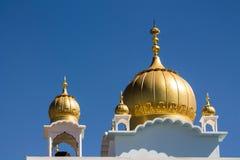 Sikh temple golden domes on the roof. In Makindu, Kenya. Sikhism religion. Guru Singh Royalty Free Stock Photos