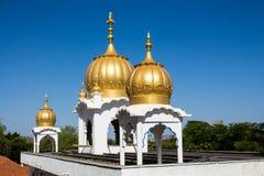 Sikh temple golden domes on the roof. In Makindu, Kenya. Sikhism religion. Guru Singh Royalty Free Stock Images
