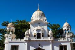 Sikh temple white domes in Makindu, Kenya. Sikh temple white dome on the roof in Makindu, Kenya. Sikhism religion. Guru Singh Stock Photos