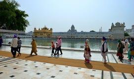 Sikh walking in the Golden Temple, Amritsar Stock Photo