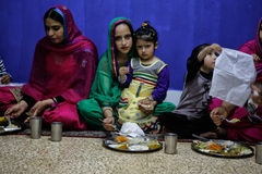 Sikh woman and daughter during dinner Stock Photo
