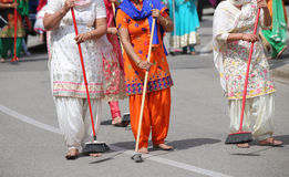 Sikh women while scavenging the street with a broom during a fes Royalty Free Stock Photo