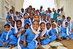 Sikh Young Students in the Golden Temple, Amritsar Royalty Free Stock Photos