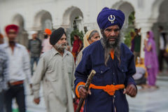 Sikhs and indian people visiting the Golden Temple in Amritsar, Punjab, India Royalty Free Stock Image