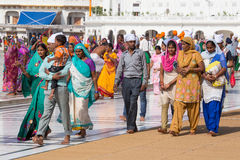 Sikhs and indian people visiting the Golden Temple in Amritsar, Punjab, India. AMRITSAR, INDIA - SEPTEMBER 29, 2014: Unidentified Sikhs and indian people Royalty Free Stock Images