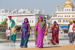 Sikhs and indian people visiting the Golden Temple in Amritsar, Punjab, India. AMRITSAR, INDIA - SEPTEMBER 29, 2014: Unidentified Sikhs and indian people Stock Photos