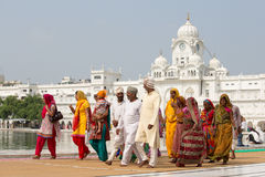 Sikhs and indian people visiting the Golden Temple in Amritsar, Punjab, India. AMRITSAR, INDIA - SEPTEMBER 26, 2014: Unidentified Sikhs and indian people Stock Photography