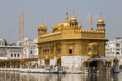 Sikhs and indian people visiting the Golden Temple in Amritsar, Punjab, India. Stock Photo