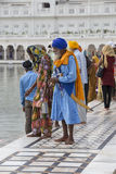 Sikhs and indian people visiting the Golden Temple in Amritsar, Punjab, India. AMRITSAR, INDIA - SEPTEMBER 26, 2014: Unidentified Sikhs and indian people Royalty Free Stock Images