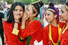 Sikkim girls in traditional attire having fun. Gandhinagar, India - March 9, 2018: Group of Sikkim girls from Nepalese community dressed in traditional attire stock photo