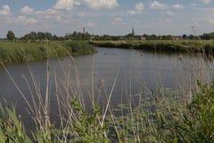 Sikt över landskap i norden av Nederländerna Arkivfoton