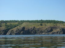 Sikt av ön med träd arkivfoton