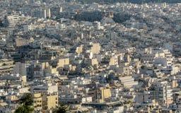Sikt av Atenstaden från Mount Lycabettus som visar vita byggnader arkitektur, Grekland royaltyfria foton
