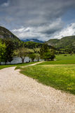Sikt av Bohinj sjön i den Triglav nationalparken Slovenien Arkivfoto