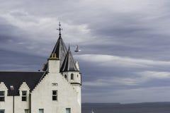 Sikt av byggnad för gryn för John nolla-` en vit Arkivfoto