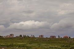 Sikt av byn i utlöparen Royaltyfria Bilder