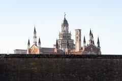 sikt av Certosa di Pavia med yttre väggar royaltyfri fotografi