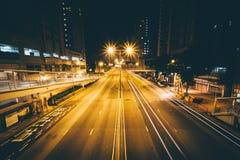 Sikt av den Aberdeen Praya vägen på natten, i Aberdeen, Hong Kong Royaltyfri Foto
