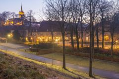Sikt av den Elsloo slotten på gryning på en dag med ogenomskinlighet arkivbilder