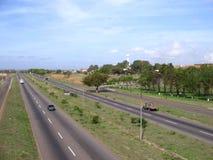 Sikt av den Guayana avenyn, vid Matanzas den industriella zonen, Puerto Ordaz, Venezuela Fotografering för Bildbyråer