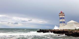 Sikt av den Santa Marta fyren i Cascais Royaltyfria Bilder