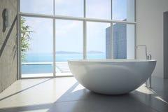 Sikt av ett rymligt och elegant badrum i Arkivbild