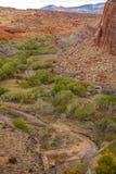 Sikt av Fruita, Utah från den Cohab kanjonslingan Arkivbilder