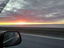 Sikt av golfen av Finland och solnedgången royaltyfria foton