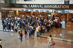 Sikt av invandringkontroll på Changi den internationella flygplatsen i S Royaltyfria Foton